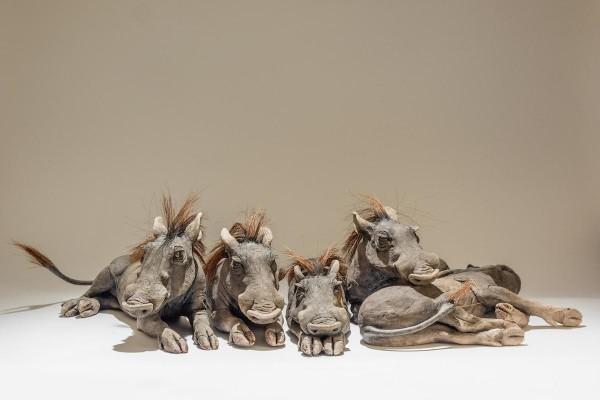 warthog baby sculptures
